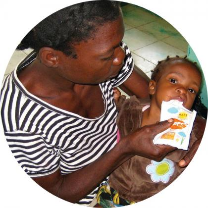 Hopegel flexible pouch being used to feed starving children